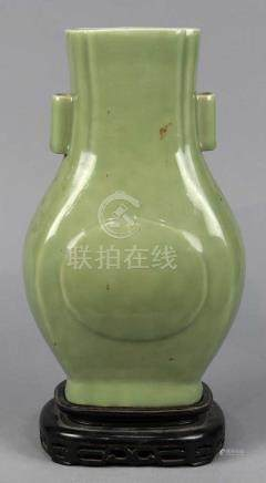 Chinese celadon glazed porcelain arrow vase, the flattened 'hu' shaped body molded with peach form