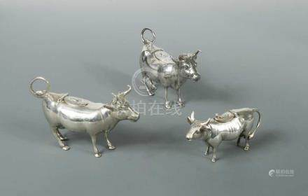 A German miniature semi-naturalistic cow creamer, marked with the Reichsmark and '835', of plain