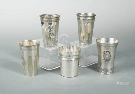 A collection of five Swiss metalwares tumblers, of conical form with applied wording relating to