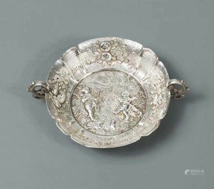 A Victorian silver two handled tastevin, sponsor mark unidentified, London import marks, 1890, in