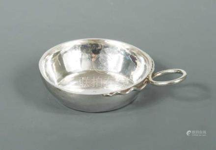 A 19th century French metalwares tastevin, of traditional circular form with beaten finish, gilded