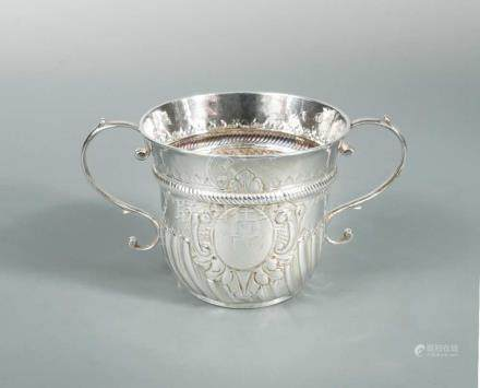 A George II silver two handled porringer, possibly by Peter Simon, London 1726, of traditional