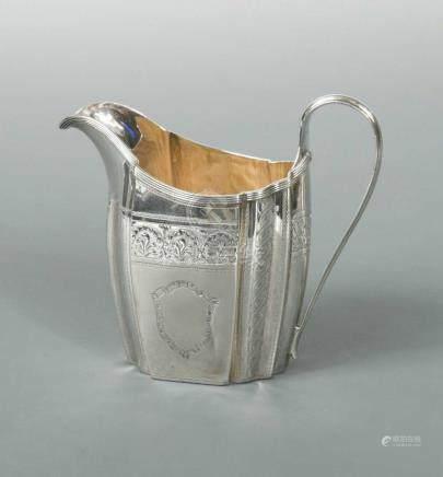 A George III silver cream jug, by Thomas Wallis II, London 1799, of oval panelled form, heavily