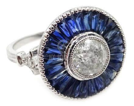Platinum (tested) diamond and calibre cut sapphire circular ring,