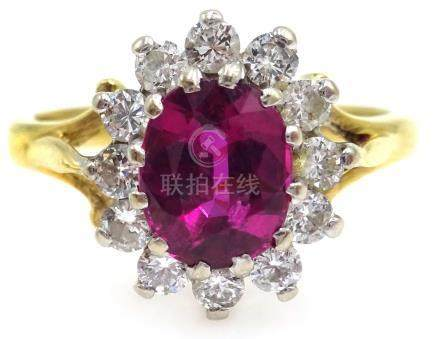 18ct gold ruby and diamond cluster ring,
