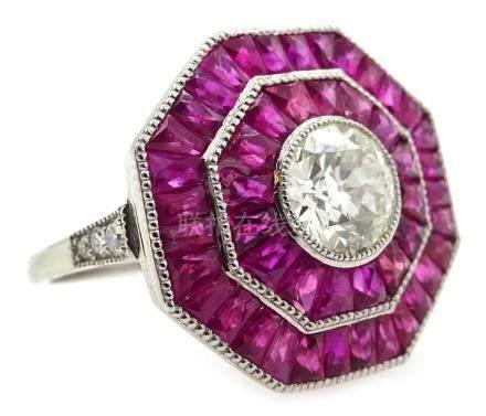 Old cut diamond and calibre cut ruby octagonal platinum (teste) target ring,