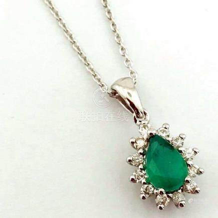 14K White Gold Cluster Pendant set with a natural emerald and 12 brilliant cut diamonds