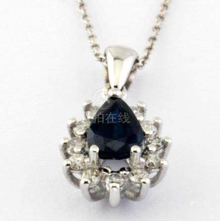 14K White Gold Cluster Pendant set with a natural sapphire and 12 brilliant cut diamonds