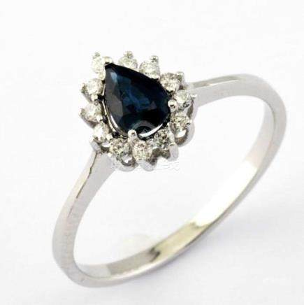 14K White Gold Cluster Ring set with a natural sapphire and 12 brilliant cut diamonds