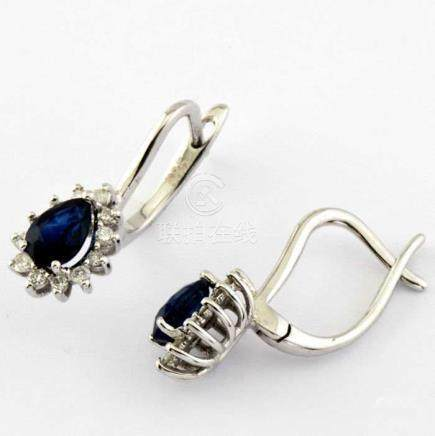 14K White Gold Cluster Earring set with 2 natural sapphire and 24 brilliant cut diamonds 1,50ct