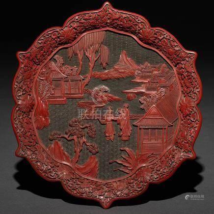 Plato polilobulado de laca color rojo cinabrio. Trabajo Chino, Siglo XX