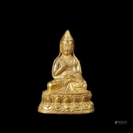 A GILT-BRONZE FIGURE OF LAMA