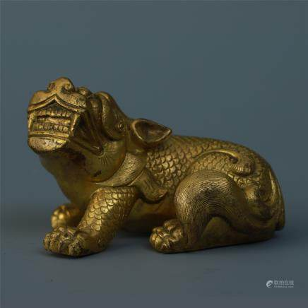 A Finely Carved Gilt Bronze Mythical Beast