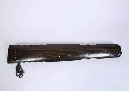 A Chinese Carved Wood Guqin