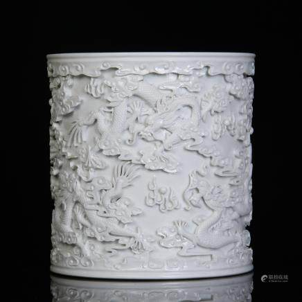 A Chinese White Porcelain Carved Brush Pot