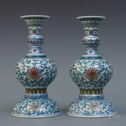 A Pair Of Chinese Famille-Rose Candle Holders