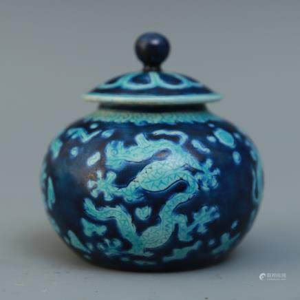 A Chinese Blue And White Porcelain Jar With Dragon Figures