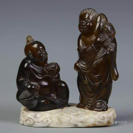 A Set of Two Chinese Carved Amber Figures