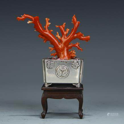 A Chinese Coral Decoration with Silver Planter