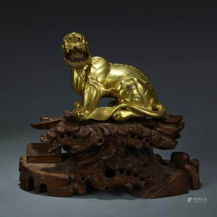 A Chinese Gilt Bronze Tiger with Rosewood Stand