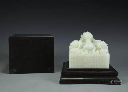 A Chinese Carved Jade Seal with Case