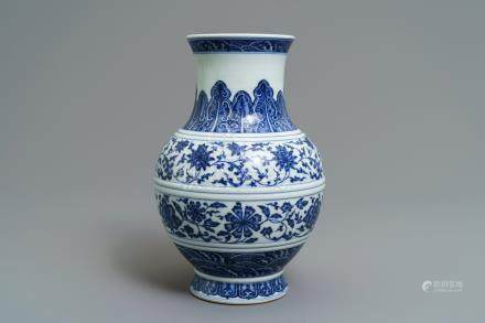 A Chinese blue and white 'flower scroll' vase, Qianlong mark, 19/20th C.