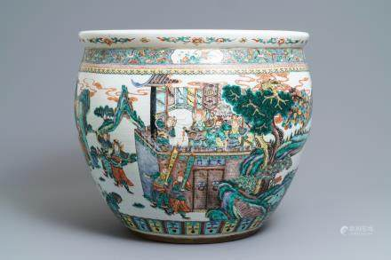 A large Chinese famille verte fish bowl with a narrative scene all-round, 19th C.