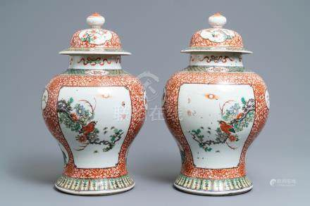 A pair of Chinese famille verte vases and covers, 19th C.