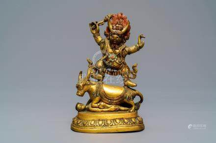 A Sino-Tibetan gilt bronze figure of Yama Dharmaraja, 18/19th C.