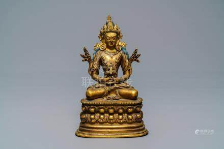 A Chinese gilt bronze figure of Amitayus, 17/18th C.