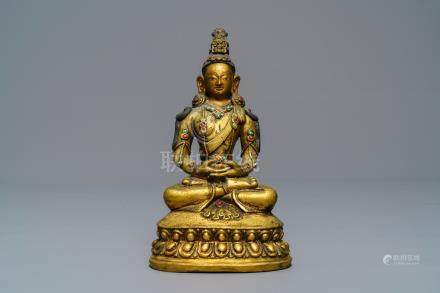 A Sino-Mongolian inlaid gilt bronze figure of Amitayus, 18/19th C.