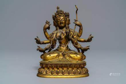 A Sino-Tibetan inlaid gilt bronze figure of Ushnishavijaya, 17/18th C.