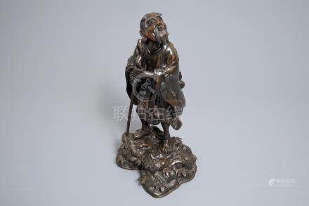 A Chinese bronze figure of Li Tieguai, 18/19th C.