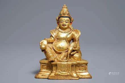 A Sino-Tibetan gilt bronze figure of Jambhala, 19/20th C.