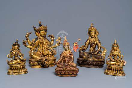 Five Sino-Tibetan gilt bronze Buddha figures, 19/20th C.