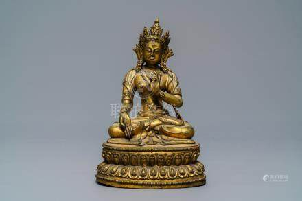 A Sino-Tibetan gilt bronze figure of a White Tara, Ming