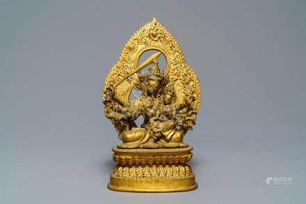 A Tibetan inscribed gilt bronze group of Manjusri and Prajnaparamita, 17/18th C.