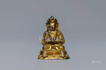 A Sino-Tibetan gilt bronze miniature figure of Buddha, 16/17th C.