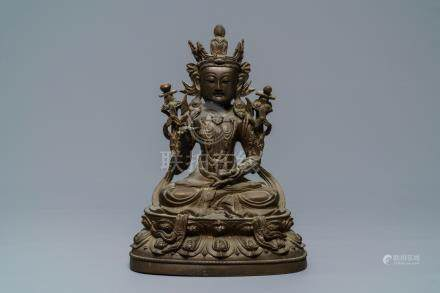 A Chinese bronze figure of Guanyin, Ming