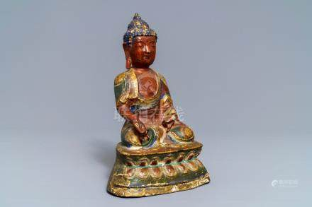 A Sino-Tibetan painted bronze figure of Buddha Bhaisajyaguru, 17/18th C.