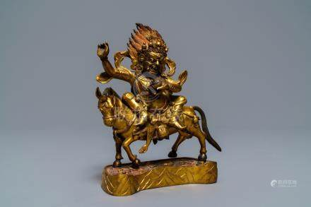 A Tibetan gilt bronze figure of Palden Lhamo, 17th C.