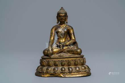 A gilt bronze figure of Buddha Shakyamuni, Tibet, 14/15th C.
