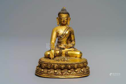 A gilt bronze figure of Buddha Vajrasana, Tibet, 15/16th C.