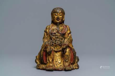 A Chinese gilt-lacquered bronze figure of Zhenwu, Ming