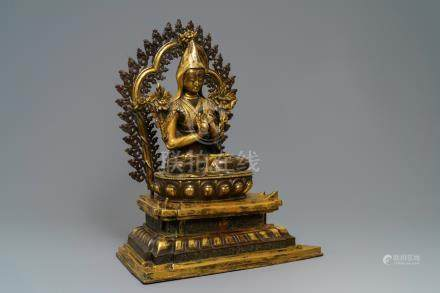 A massive parcel-gilt bronze figure of the seated Tsongkhapa, China or Tibet, 19/20th C.