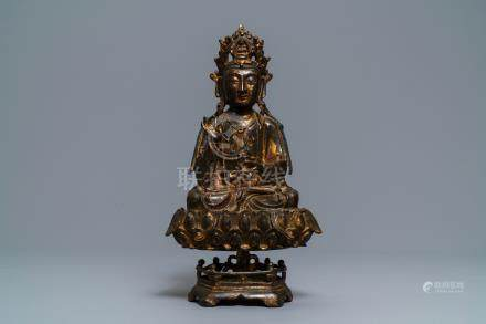 A Chinese gilt-lacquered bronze figure of Guanyin on a lotus throne, Ming