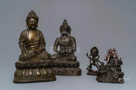Four various Chinese and Tibetan bronze figures, 18/19th C.