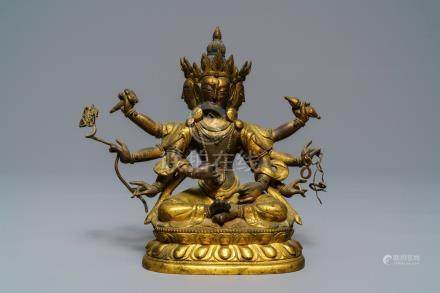 A Sino-Tibetan inlaid gilt bronze figure of Ushnishavijaya, 18th C.