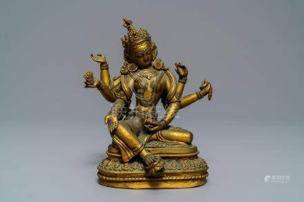 An inlaid gilt bronze figure of Vasudhara, Tibet or Nepal, 18/19th C.