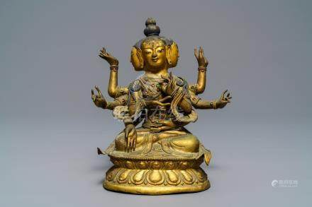A Sino-Tibetan inlaid gilt copper alloy figure of Ushnishavijaya, 18th C.